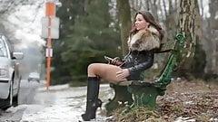 Hooker in fox fur jacket & high heels boots