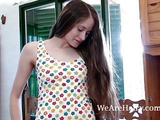 Wooden swinging balls - July undresses and masturbates on her wooden table