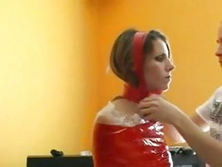 Breathable bondage tape - Mummified bondage babe in red tape