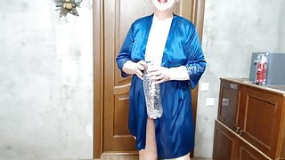 Curvy woman pees in a bottle and then drinks piss from a glass