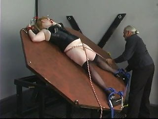 Fetish pro dom Slave gets on wheel and bound with rope and cuffs by dom