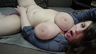 Chubby girl pleases herself lying on the couch