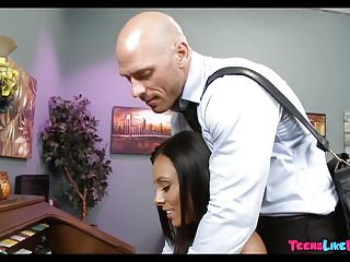 Asians piano lessons Piano teacher shows her a lesson