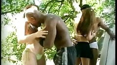 Two white girls with two black men on beach