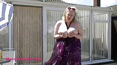 its a sunny day & Sally gets her big tits out in the garden