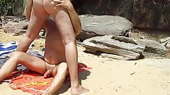 nat interupts two guys talking at the beach