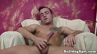 Muscular English twink toys ass while wanking