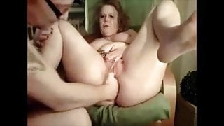 Fisting a big granny's asshole and cunt