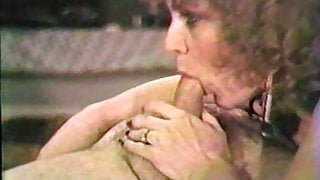 Curly MILF giving a blow job