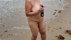 Happy wife dancing nude at a nude beach in florida