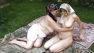 Lesbian Russian grandma licks young girl outdoor