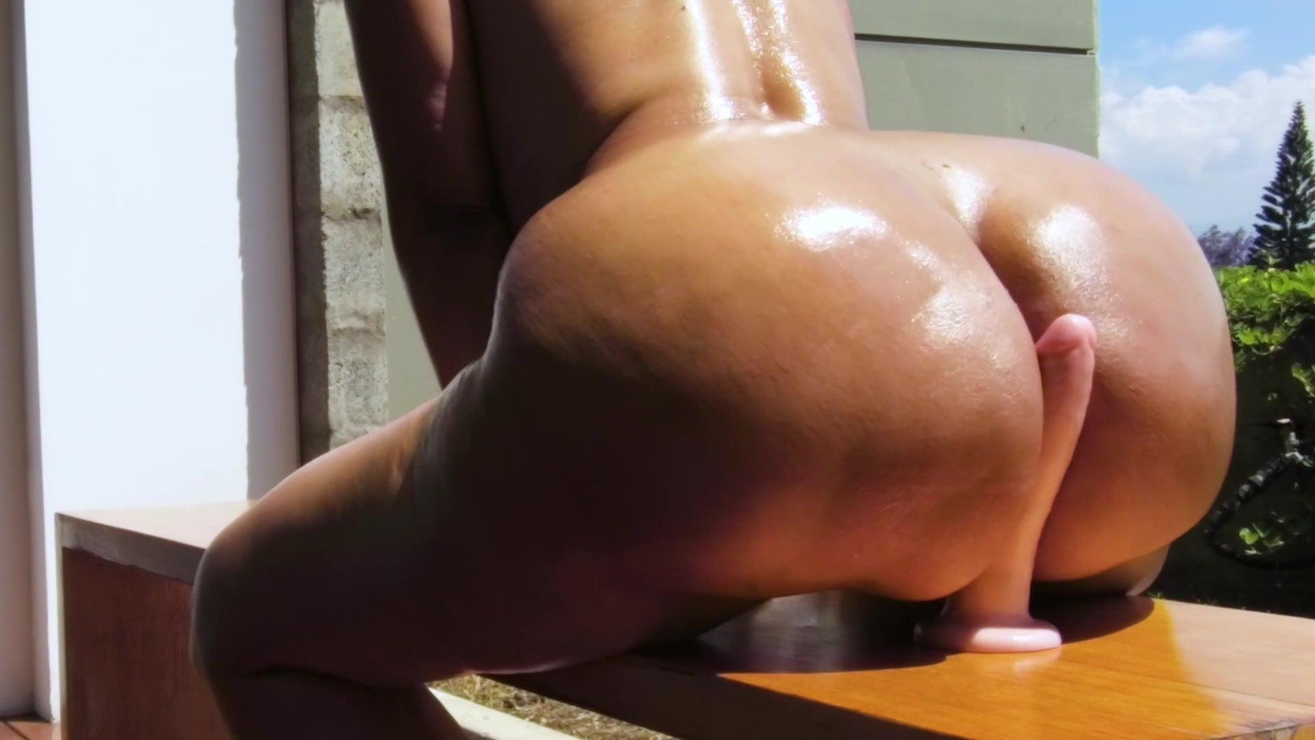 oiled ass riding big dildo