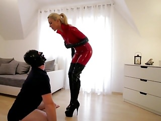 Slut in boots - Slut in red latex cat suit black boots fucks slave
