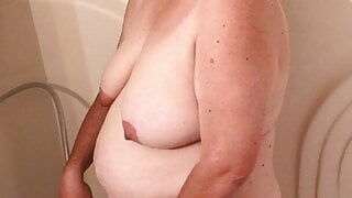 Naomi takes a shower