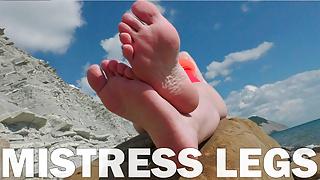 Mistress Legs Barefoot On The Summer Sea Beach