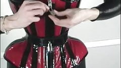 extremely tight corset for a delinquent slave.