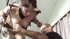 Ass hooked Brunette in bondage device on treadmill