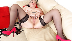 British mature Candy Cummings masturbates on sofa