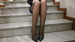 Leila in mini skirt, black stiletto and black la perla tight