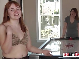 Amateur hockey divisions - Two redhead girls play a game of strip air hockey