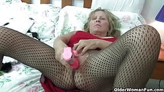 Grandma with big breasts rips open her pantyhose