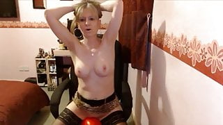 MILF rides her rubber cock to orgasm