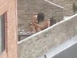 Voyeur house sex cams Tranny and girl fuck on the roof of the house