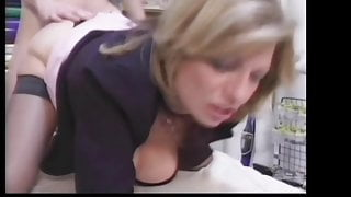 Lucky guy gets cauth by his blonde MILF boss in stockings