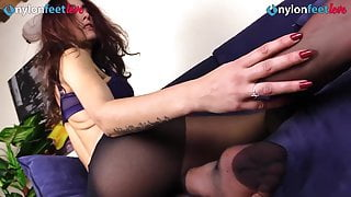 Sexy redhead in black pantyhose shows perfect ass and feet