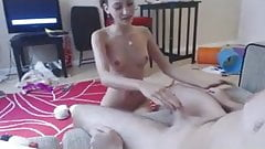 Beautiful dark haired girl gives cock massage