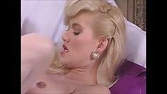 Gorgeous Blonde in white stockings fucked on the sofa