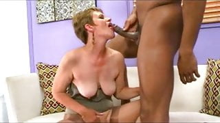 Cute short haired granny taking black cock
