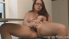 Nerdy brunette loves to use her black dildo