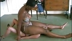 Black amazon sitting fullweight on small slave girl