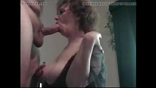 Busty grandma with glasses gives head and gets cum