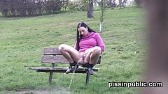 Peeing babes empty their bladders in a park