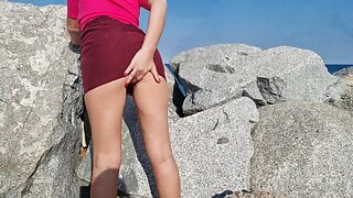 Horny girl gets naughty and squirts all over the beach