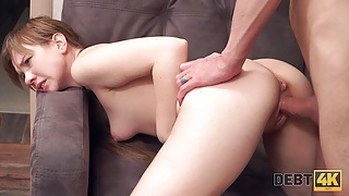 Debt4k. Red-haired miss reaches orgasm and returns the debt