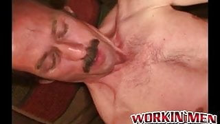 Guy with a mustache tugs his cock before cumming hard