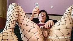 Review of a new toy in a big hairy pussy in fishnet pantyhos