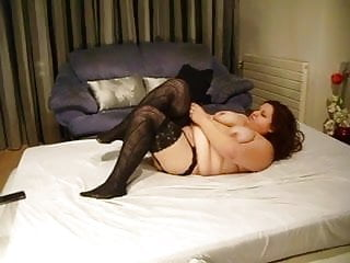 Woman sticks fish in pussy Fat on couch sticks dildo in pussy