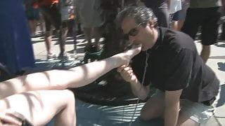 Man licks women feet in public