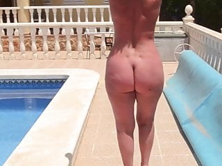 Mature bare asses Mature with a naked bare ass walks by the pool