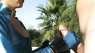 Odd girl In Blue Latex Gives HJ