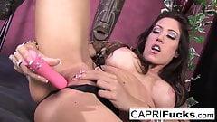 Watch as busty hottie Capri fucks her tight wet pussy