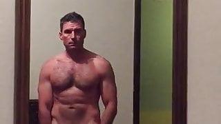 Muscular man undressing selfie video