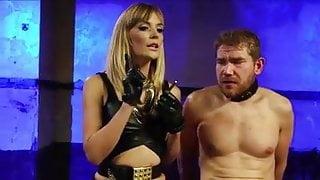 Mistress fucks slave with strapon.