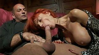 La Venere Bianca with long red fingernails sucking cock