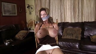 Big tits MILF tightly tied to chair and tape gagged