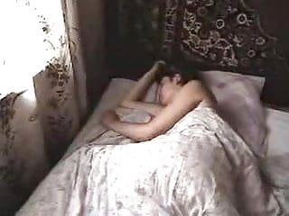 A naked woman in a bed - Naked woman at bed